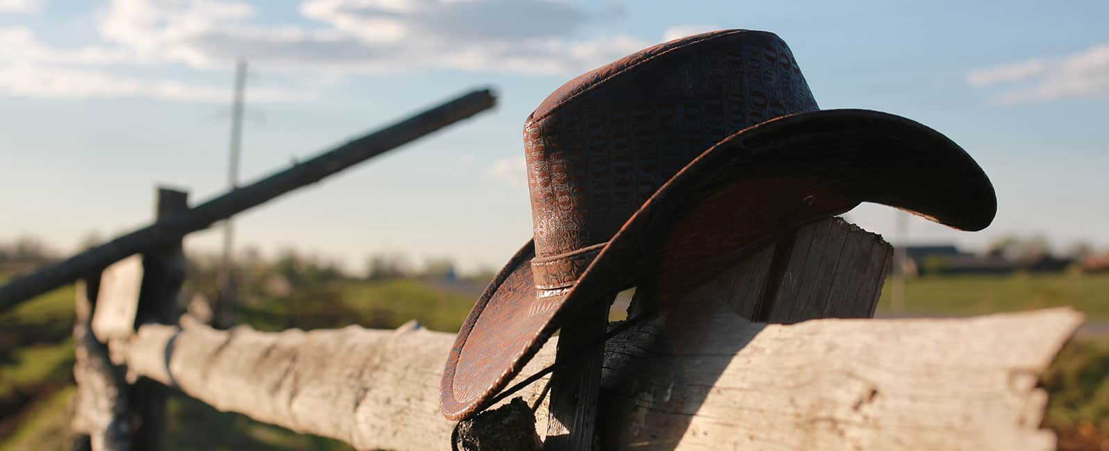 Cowboy Hat on wooden fence